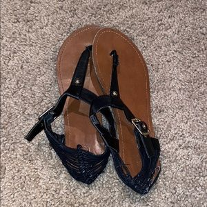 Sandals with slight wear and tear